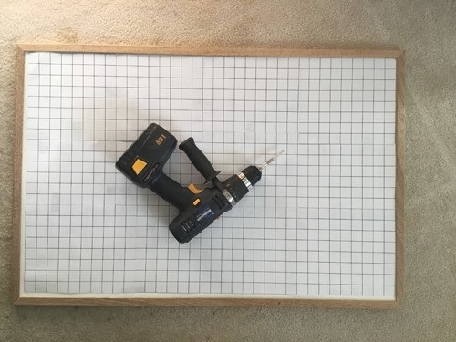 Photo of drill, board, graph paper